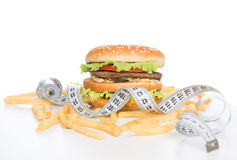 Burger cheeseburger meal with french fries tape measure Stock Photo