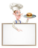 Burger Chef Pointing at Sign Stock Photography