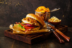 Burger with chicken breast and fried onions Royalty Free Stock Photography