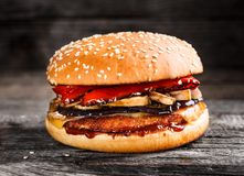 Burger with chicken patty and vegetables Royalty Free Stock Photo