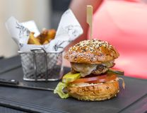 Burger. Chicken Burger on a slate plate Royalty Free Stock Photography
