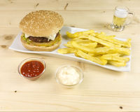 Burger and chips Stock Images