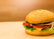 Burger close-up on a board. A burger with a meatball and fresh vegetables Stock Photography