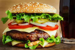 Burger with cola. On wooden table stock photos