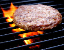 Burger Cooking On The Grill Royalty Free Stock Image