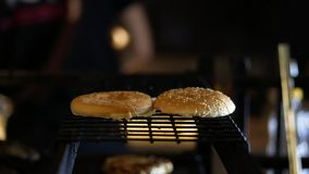 Burger cooking on the grill at the restraunt kitchen. Preparing a batch of ground beef patties or frikadeller on grill or BBQ Stock Image