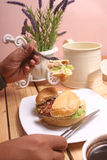 Burger dish is ready to eat and a cup of black coffee Royalty Free Stock Image