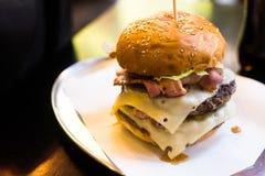 Burger. Double cheeseBurger on a plate Stock Photos