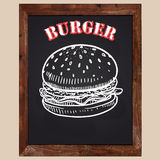 Burger drawn with chalk on a black background Royalty Free Stock Photo