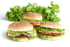 Burger drei mit Fleisch und Gemüse Lizenzfreie Stockfotos