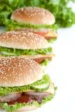 Burger drei mit Fleisch und Gemüse Lizenzfreie Stockbilder