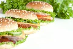 Burger drei mit Fleisch und Gemüse Lizenzfreies Stockbild