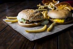 Burger, fast food hamburger menu and french fries. Stock Photo