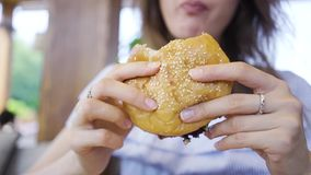 Burger in female hands close up leaking stock video footage