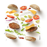 Burger with flying ingredients Stock Image