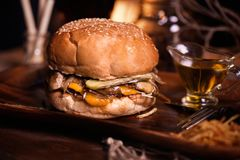 Burger food photo. Street food. Fresh tasty grilled beef hamburger cooked at barbecue on wooden table. Big cheeseburger Royalty Free Stock Photo
