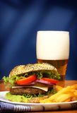 Burger, french fries and beer stock photography