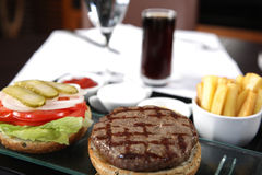 Burger, french fries and cola. Open Burger with french fries sauces and cola Stock Photography
