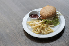 Burger and French Fries with sauce Royalty Free Stock Photo
