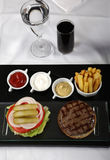 Burger and french fries served on classic way. Burger and french fries on a classic table Stock Photo