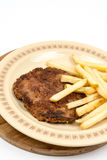 Burger with french fries served on the plate. Minced meat hamburger with potatoes isolated over white background stock photography