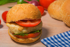 Burger with fresh vegetables Royalty Free Stock Image