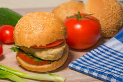 Burger with fresh vegetables Royalty Free Stock Photo