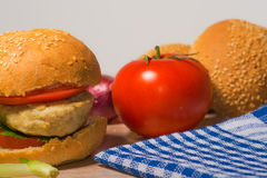 Burger with fresh vegetables Royalty Free Stock Photos