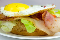 Burger with fried eggs and bacon Stock Photography