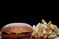 Burger fries black background Stock Photos
