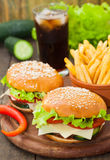Burger with fries and cola. Burger with fries, cheese, salad and cola Royalty Free Stock Photography