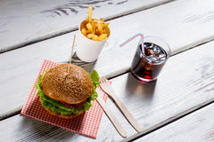 Burger and fries with cola. Royalty Free Stock Photos