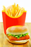 Burger with fries and fish Royalty Free Stock Image