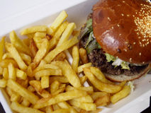 Burger with fries. Foreground of burger with fries royalty free stock photos