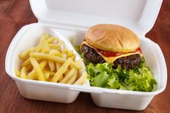 Burger with fries. Burger and fries portion in takeout food box Royalty Free Stock Photography