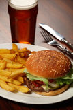 Burger and fries at a Pub. Photo of a burger with fries and a cold beer served at a Pub royalty free stock photo