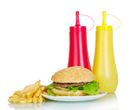 Burger, fries and sauces isolated on white Stock Image