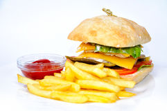 Burger and fries with tomato sauce. Royalty Free Stock Image