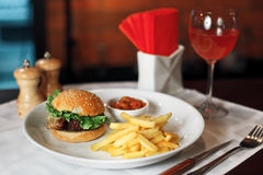 Burger with fries Stock Images