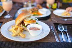 Burger and fries on white plate for lunch Royalty Free Stock Images