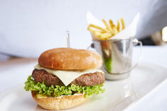 Burger with fries. On white plate studio shot Stock Photo