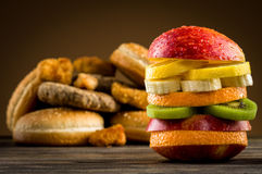 Burger with fruit. On the table Stock Images