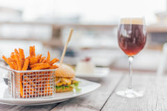 Burger with a Glas of Beer Stock Photography