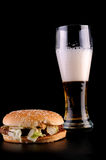 Burger and glass of beer Stock Photos