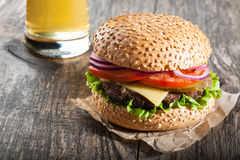 Burger and a glass of beer Royalty Free Stock Photos