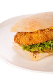 Burger with golden crumbed chicken breast Royalty Free Stock Photography