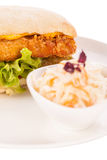 Burger with golden crumbed chicken breast stock image