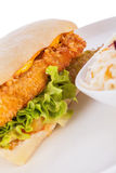 Burger with golden crumbed chicken breast Stock Photography
