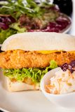 Burger with golden crumbed chicken breast Stock Images