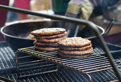 Burger Grill. A bunch of newly grilled hamburgers Royalty Free Stock Image